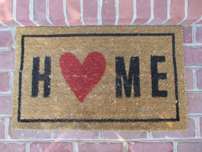 """Welcome Mat reading """"Home"""" with a heart instead of an """"o"""""""