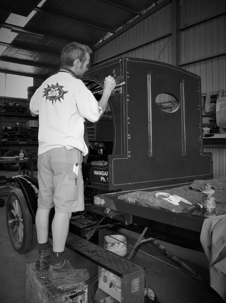 Chris handpainting truck bw