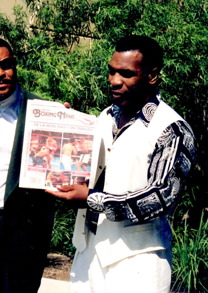 Mike Tyson reading The USA Boxing News after his press conference for his upcoming bout against Orlin Norris