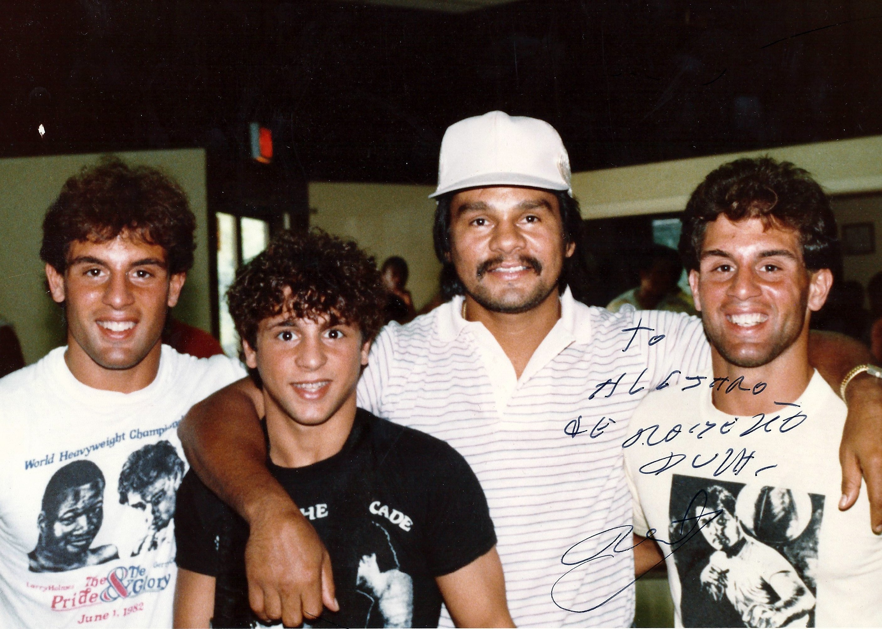 Roberto Duran surrounded by Alex, Gerard, and John Rinaldi in 1982