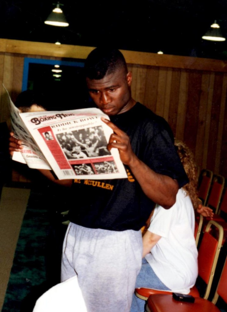 """Super Middleweight Champion James """"Lights Out"""" Toney reading the USA Boxing News"""