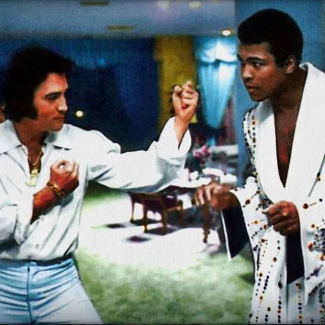Elvis Presley squares off with Muhammad Ali who is wearing the robe that Elvis had made for him before his bout with Joe Bugner