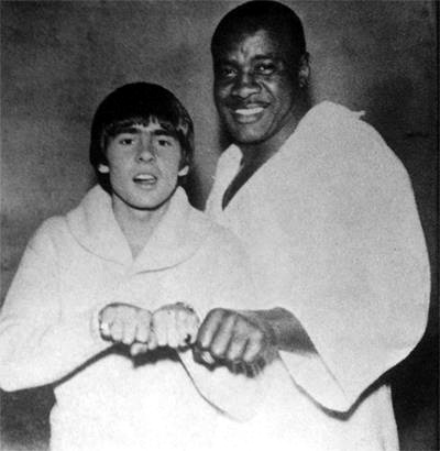 Davey Jones of The Monkees with Former Champ Sonny Liston (Click Photo to View Movie Clip of the m boxing in the movie HEAD)