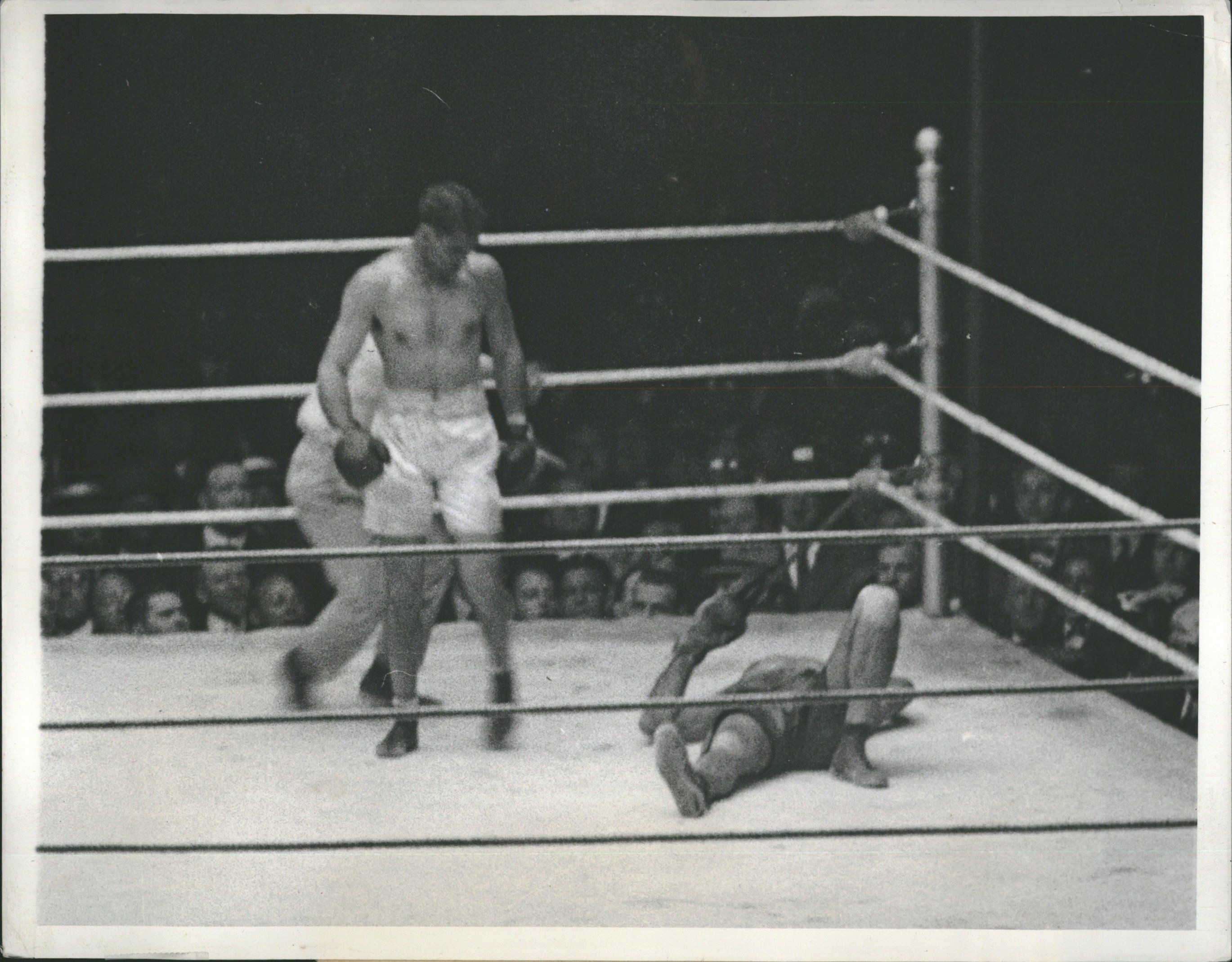 Jack Dempsey knocks at Challenger Luis Angel Firpo in 1923 (CLICK ON PHOTO TO VIEW FIGHT CLIP)