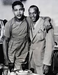 Joe Louis (L) with Olympic Track Champion Jesse Owens (R) in 1936