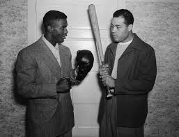 Jackie Robinson (L) with Joe Louis (R) in 1948
