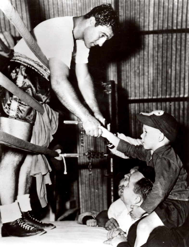 Rocky Marciano shaking hands with young fans