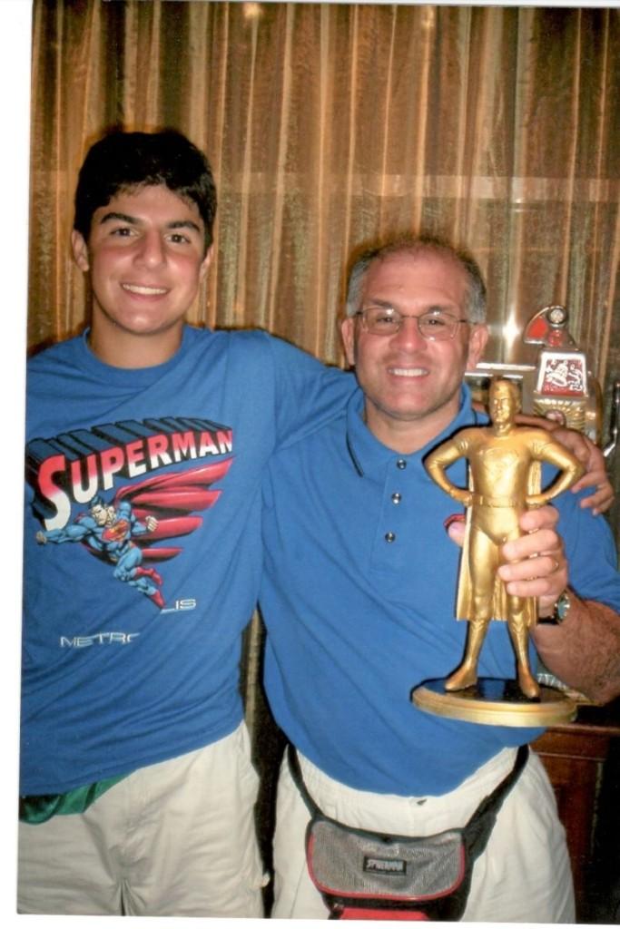 John Rinaldi and son Joseph receiving the George Reeves Superman Award in 2006.
