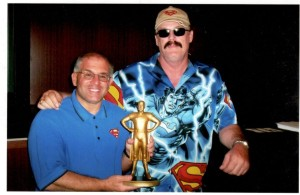 John Rinaldi presented with the George Reeves Superman Award by Jim Hambrick in 2006.