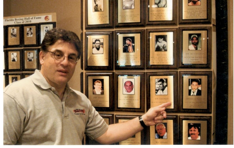 Alex Rinaldi points to plaque of Hall of Famer Gerard Rinaldi