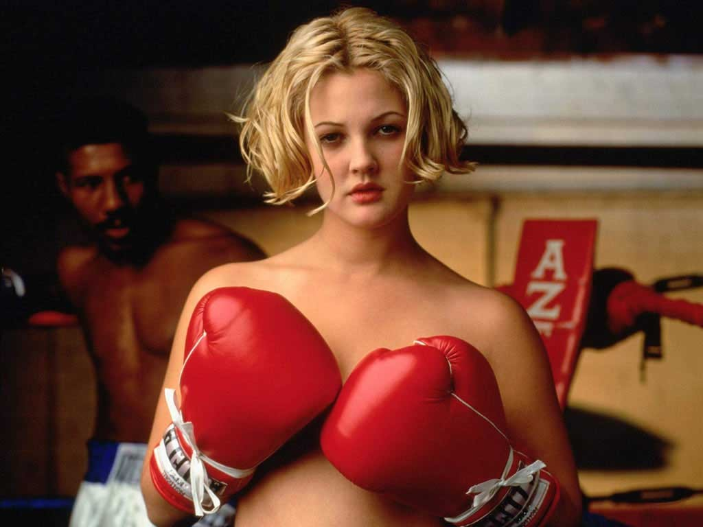 Actress Drew Barrymore strikes a boxing poses