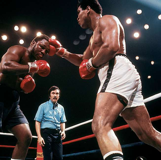 10/01/75 Muhammad Ali vs. Joe Frazier - Araheta Coliseum, Quezon City, Manila Phillippines. Ali lands a right hand to the head of Joe Frazier during the third of their three bouts. Ali won on a 15 round KO. Credit: Neil Leifer SetNumber: X19895