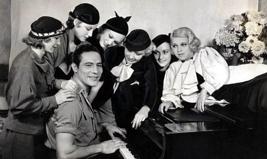 Heavyweight Champion Max Baer with a group of Hollywood beauties