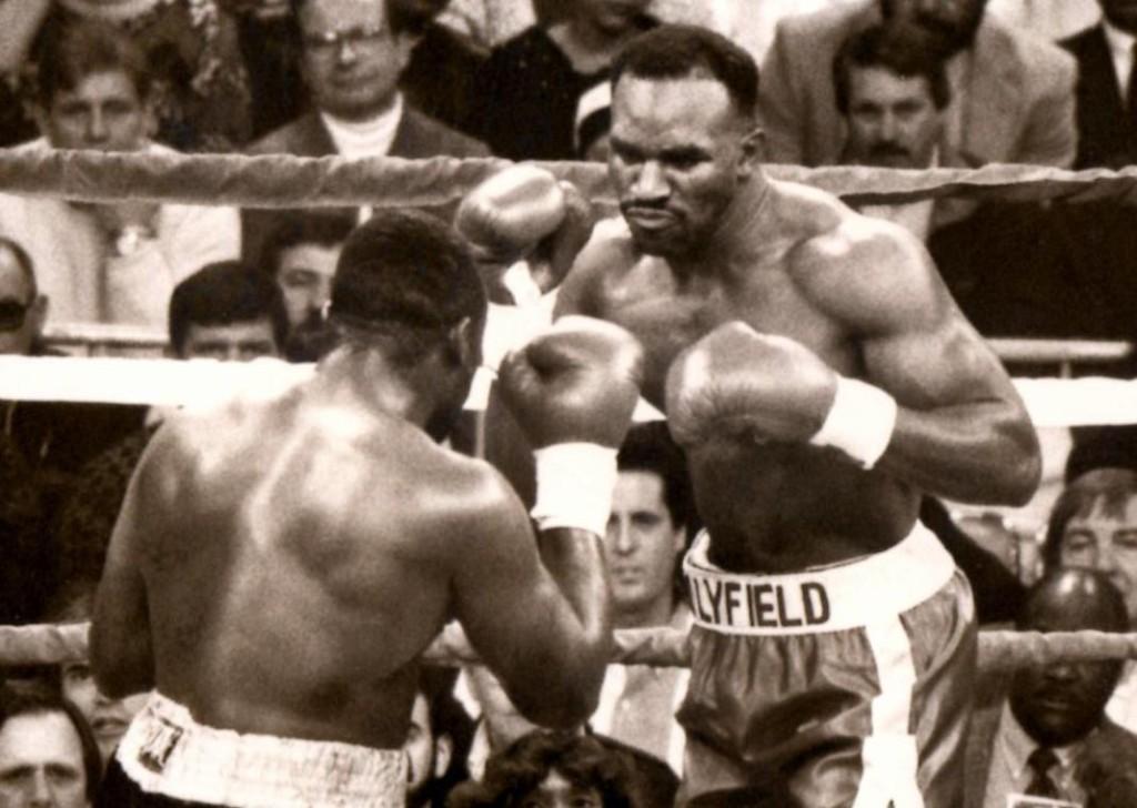 Evander Holyfield (R) vs. Smokin' Bert Cooper in 1991. Holyfield retained his title by TKO 7 * (PHOTO BY ALEX RINALDI)
