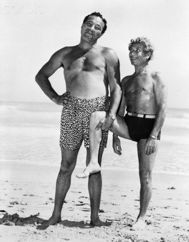 01 Mar 1946, Miami Beach, Florida, USA --- Original caption: 3/1/1946-Miami Beach, FLMaxie Baer plays stooge to Harpo Marx on the oceanfront at the Roney Plaza Hotel. It's one of Harpo's well known movie gestures--when he's not racing after blondes. --- Image by © Bettmann/CORBIS