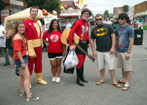 Captain Marvel with one of the Super Monkees with fans