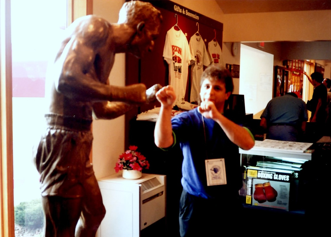 Gerard squaring off with a statue of Carmen Basilio at the Boxing Hall of Fame