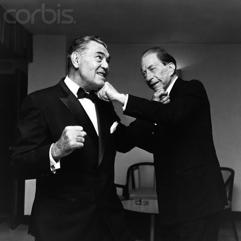 1967 --- The American oil executive, multi-millionaire and art collector, Jean Paul Getty I (r), pretends to box with the former heavyweight champion, Jack Dempsey, 1967. --- Image by © Hulton-Deutsch Collection/CORBIS