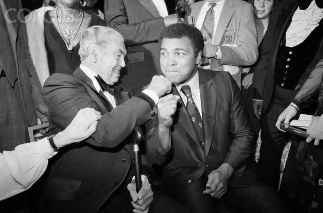 02 Feb 1981 --- Original caption: 2/2/1981-New York, NY- Jack Dempsey takes a poke at Muhammad Ali during the first Thurman Award Dinner of the Association for the Help of Retarded Children. The award, a tribute to the late Thruman Munson, in recognition of his interest in the mentally retarded, was presented to Dempsey, Ali, Billy Martin, Senator Bill Bradley, Ralph Kiner, Cliff Robertson, Ethel Kennedy, and Munson's widow, Diana. --- Image by © Bettmann/CORBIS