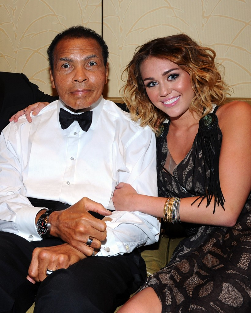Miley Cyrus with Muhammad Ali.