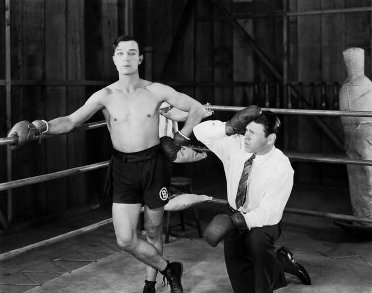 1926: American comedian Buster Keaton (1895-1966) in the boxing ring with a confused looking trainer in his latest film 'Battling Butler'.