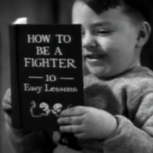 Spanky with boxing book.