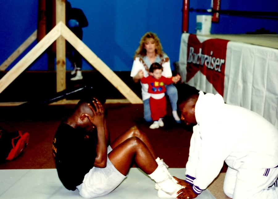 """IBF super Middleweight Champion James """"Lights Out"""" Toney training for his April 17, 1993 against Ricky Thomas where Toney scored a TKO 10. A young Ron John rinaldi and Toney's manager Jackie Kallen are in the background. (PHOTO BY ALEX RINALDI)"""