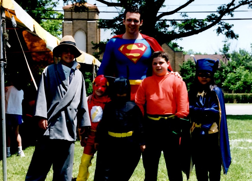 Superman with some younger heroes