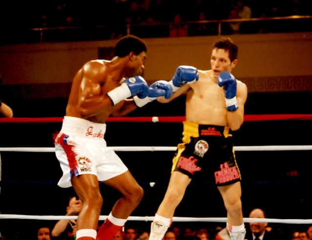 """Julian """"The Hawk""""Jackson preparing to knock out Agostino Cardamone to capture WBC Middleweight Title on March 17, 1995 at Municipal Stadium in Worcester, MA. (PHOTO BY ALEX RINALDI)"""