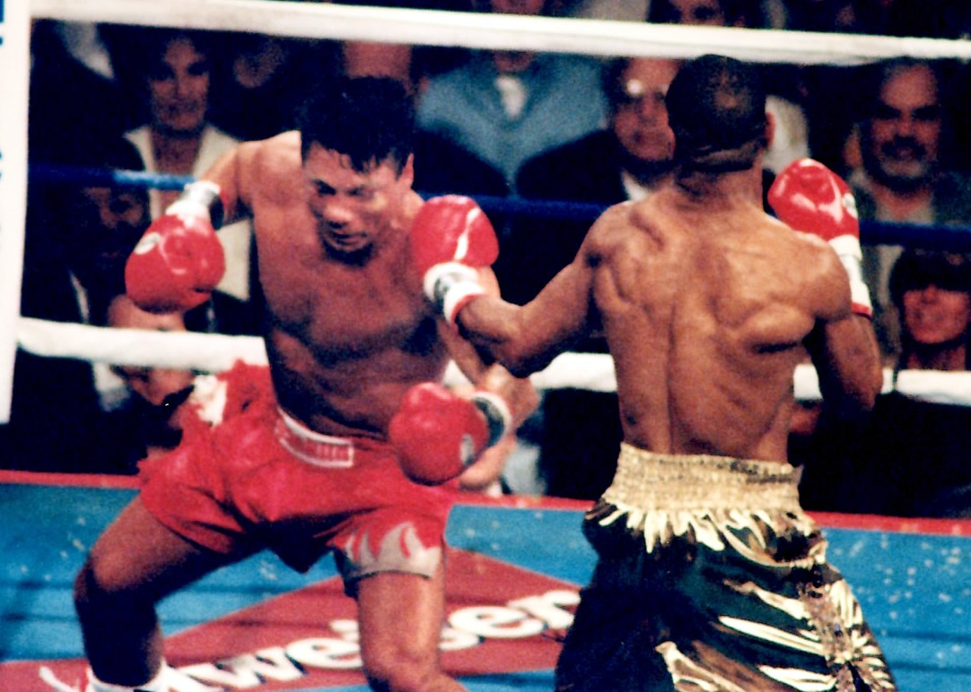 Roy Jones Jr. battling Vinny Pazienza on June 24, 1995 for the IBF super middleweight title, which Jone s retained via 6th round TKO