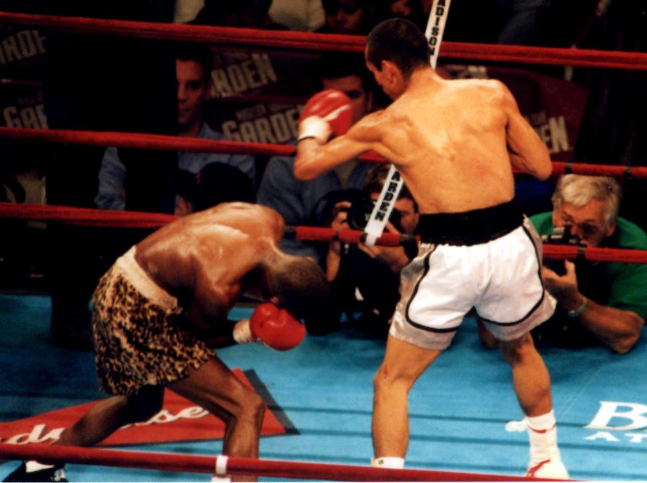 Ricardo Lopez (R) banging away at challenger Zolani Petelo (L) in defense of his IBF Light Flyweight Title on September 29, 2001, in New York's Madison Square Garden (PHOTO BY ALEX RINALDI)