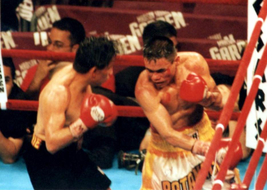 Former IBF Super Flyweight Champion Danny Romero and former WBO World bantamweight champion Ratanachai Sor Vorapin exchange blows in their bout on September 29, 2001, in New York's Madison Square Garden,. Lopez retired after the bout with an unbelievable record of 51-0-1! (PHOTO BY ALEX RINALDI)