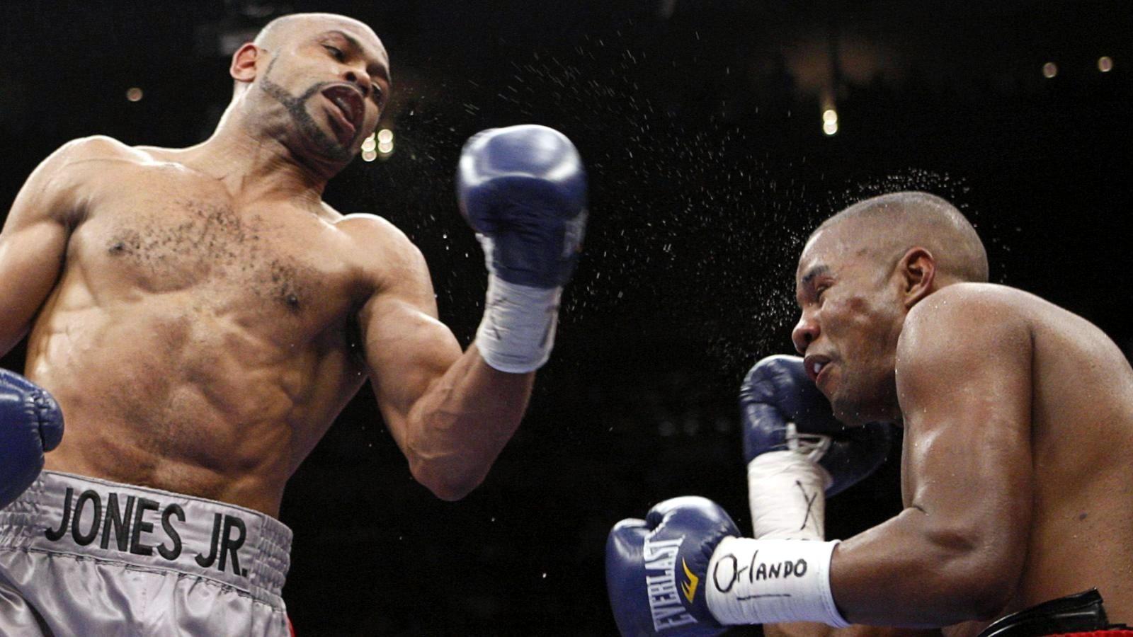 Jones-Trinidad - Jones lands a vicious uppercut.