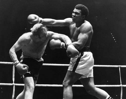 Muhammad Ali Richard Dunn slugs it out with Muhammad Ali. (CLICK PHOTO TO VIEW VIDEO)