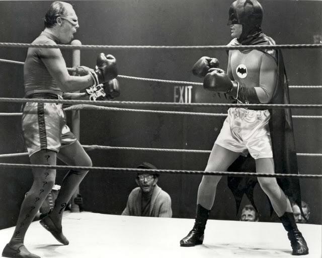 Batman boxing the Riddler.