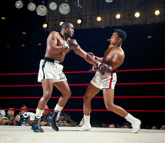 Liston (L) going after Ali (R)