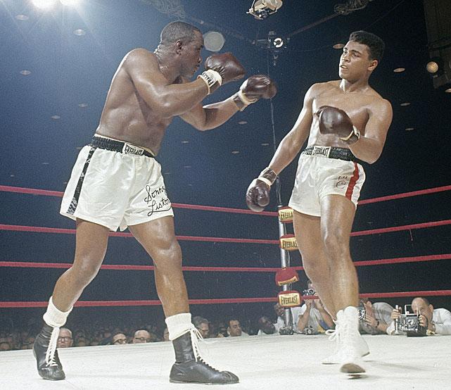 Liston (L) looks to land the jab at Ali (R)
