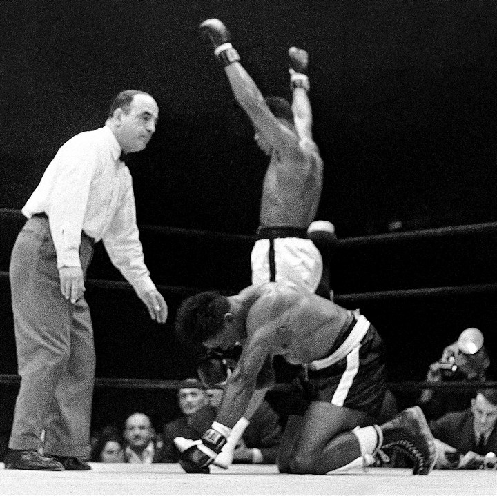 Cassius Clay finishes off Charlie Powell in Round 3.