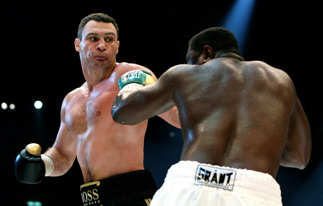 Ukrainian boxer Vitali Klitschko (L, combat name: Doctor Ironfist) exchanges punches with Nigeria's Samuel Peter (R, combat name: The Nigerian Nightmare) during their WBC heavyweight title fight on October 11, 2008 in Berlin. Vitali Klitschko became a world champion for the third time after beating Peter to win back the WBC heavyweight belt with a technical knock-out in the ninth round here. AFP PHOTO DDP/RONNY HARTMANN GERMANY OUT (Photo credit should read RONNY HARTMANN/AFP/Getty Images)