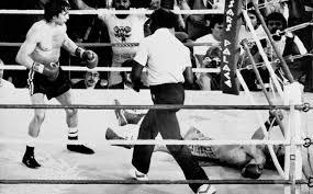 A Ray 'Boom Boom' Mancini knocks out Duk Koo Kim