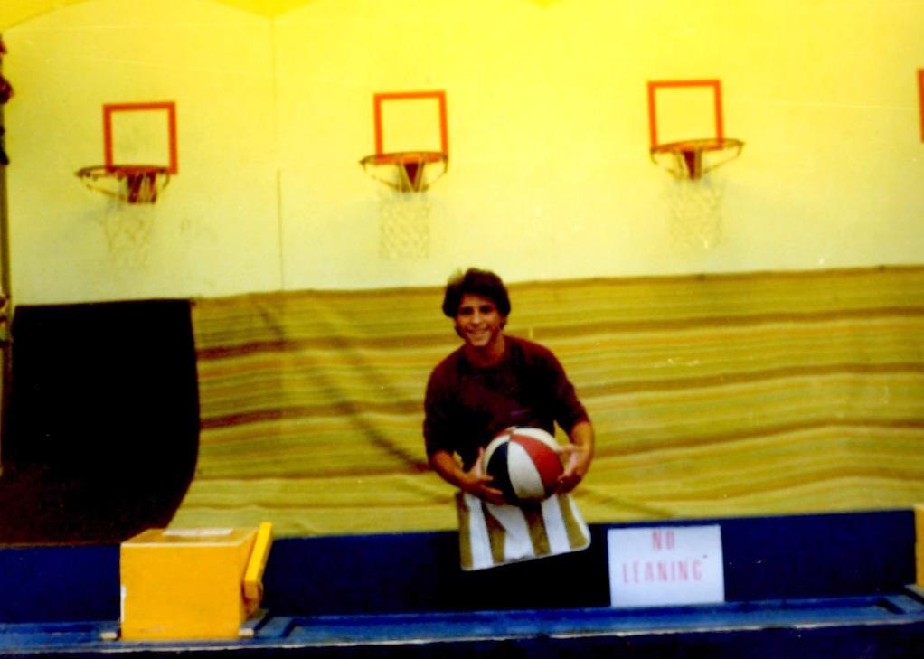 Gerard Rinaldi manning the basketball stand at Bertrand's Island Amusement Park in 1981.