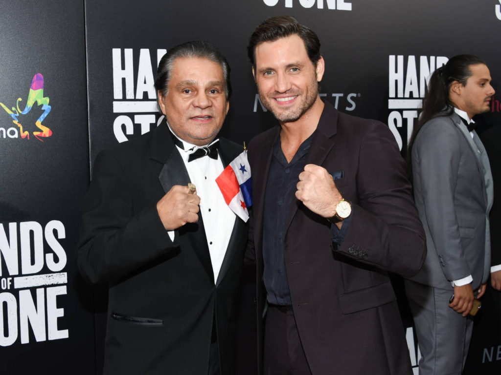 """Former professional boxer Roberto Duran, left, and actor Edgar Ramirez, who plays Duran in the film, pose together at the U.S. premiere of """"Hands of Stone"""" at the SVA Theatre on Monday, Aug. 22, 2016, in New York. (Photo by Evan Agostini/Invision/AP)"""