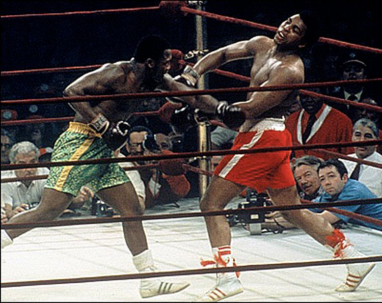 Joe Frazier landing a left hook to Muhammad Ali's chin in their iconic 1971 Heavyweight Championship Super Fight