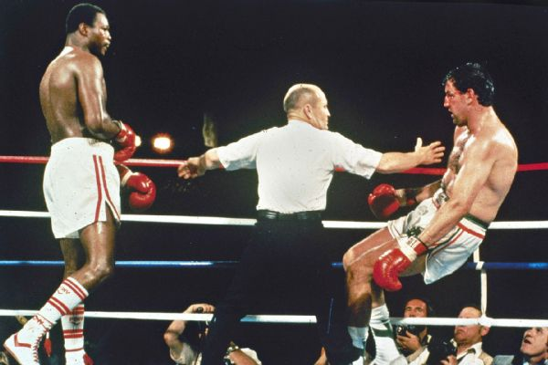 Holmes stopping Cooney in the 14th round.