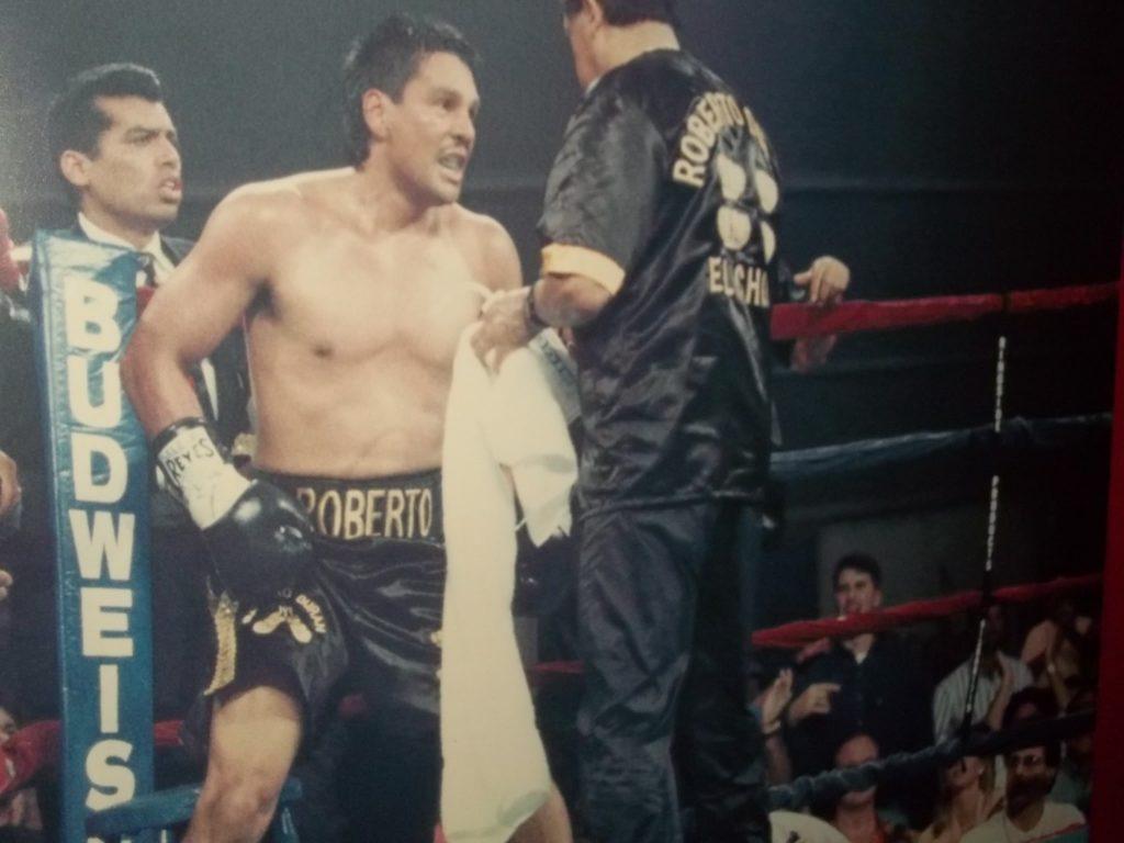 Roberto Duran in 100th fight against Tony Menefee with The USA Boxing News editor John Rinaldi at bottom.