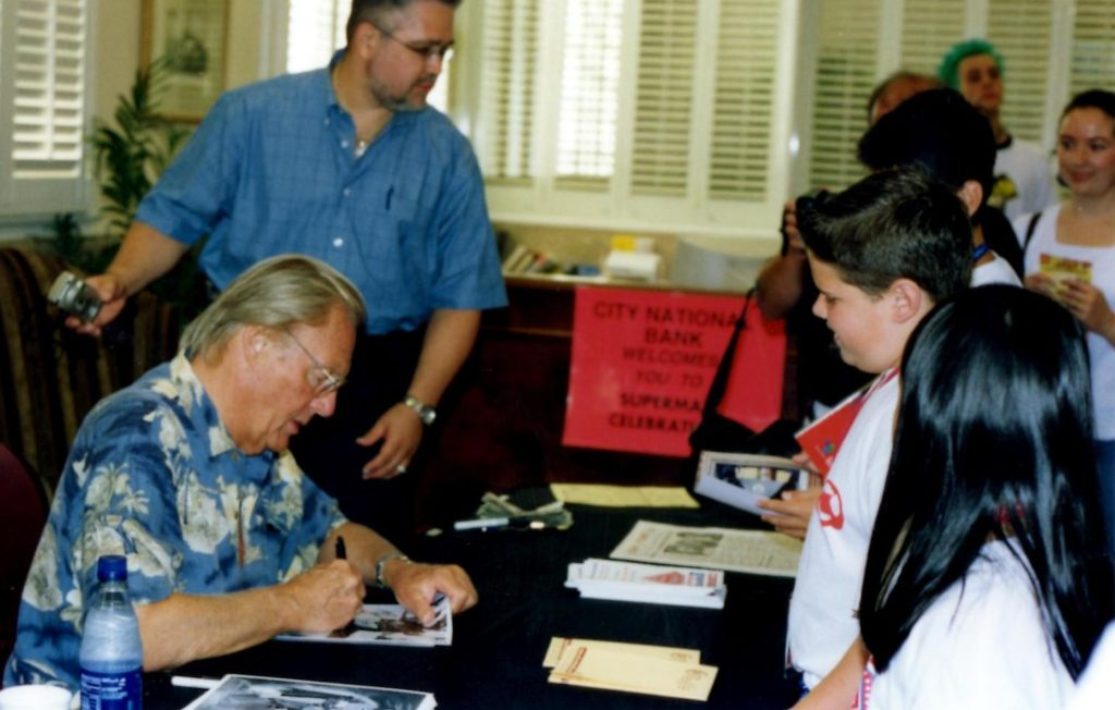 Adam West signing autographs at the Superman Celebration in Metropolis, Illinois.