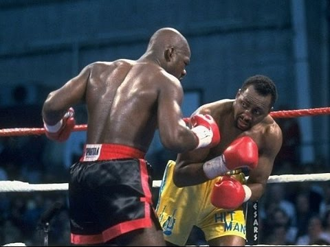 Barkley (L) trading leather with Tommy Hearns in their second fight.