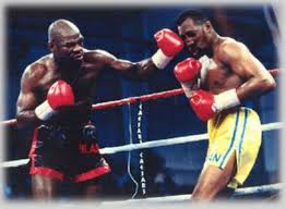 """Iran Barkley (L) nailing Thomas """"Hit Man"""" Hearns (R) with a left hook en route to capturing the WBA World Light Heavyweight title on March 20, 1992."""