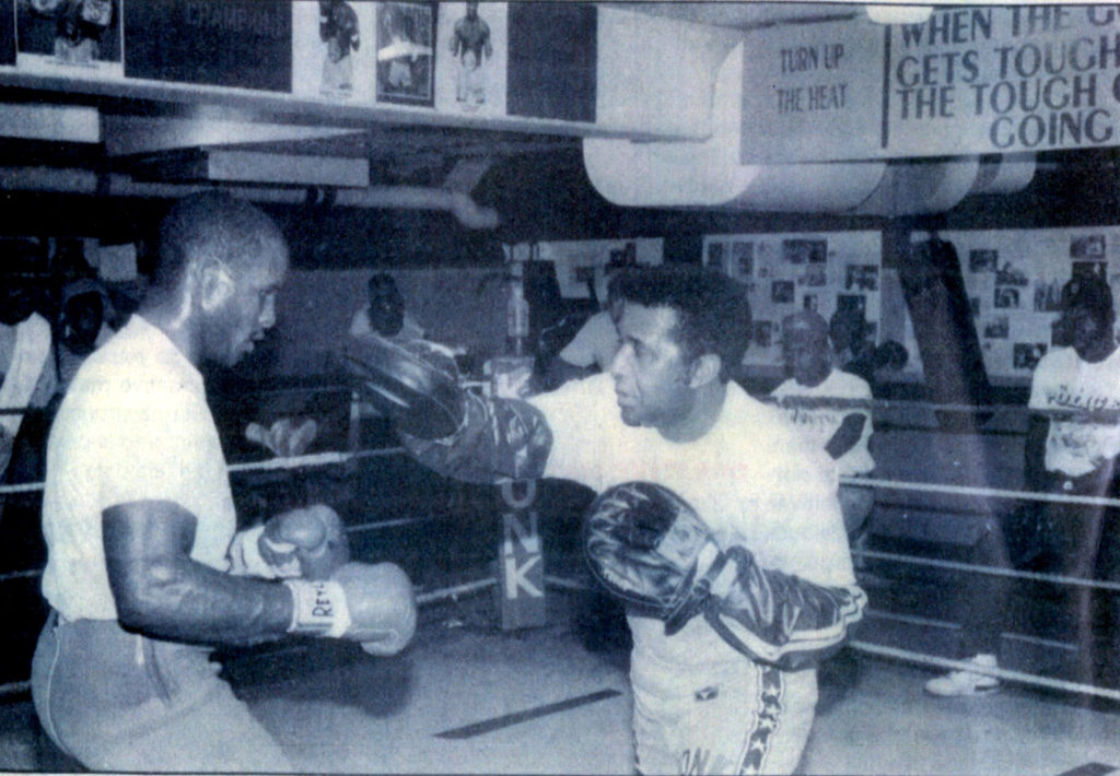 """Michael Moorer (L) working out with KRONK trainer Emanuel """"Manny"""" Steward"""