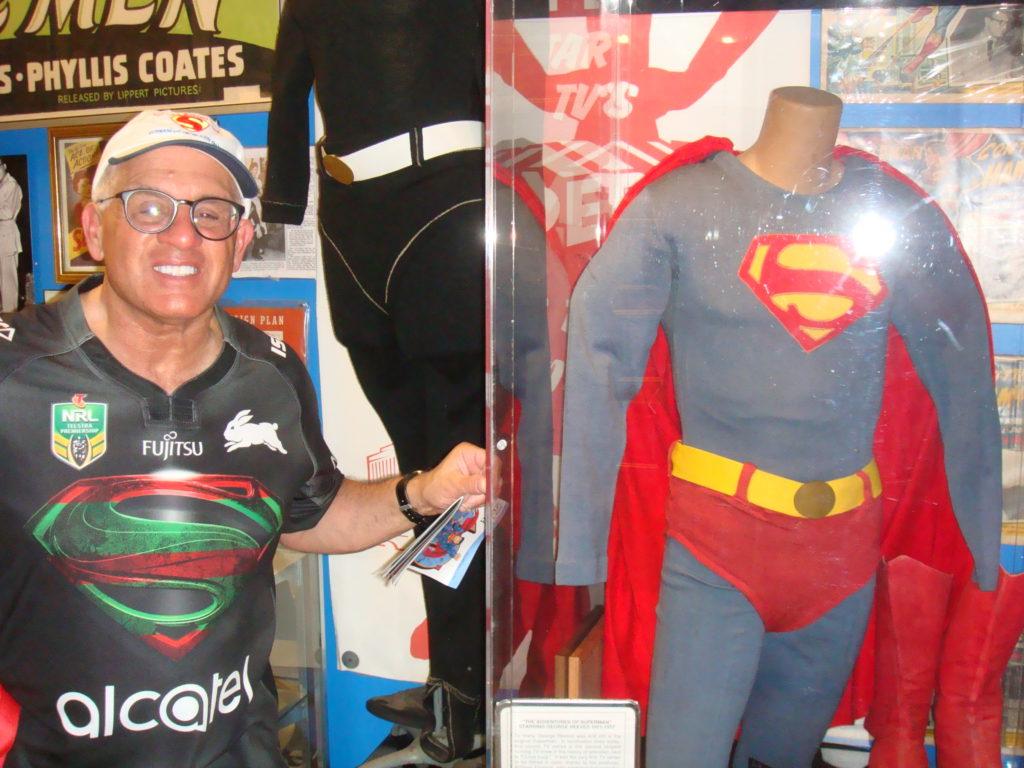 "John Rinaldi vieweing the George ""Superman"" Reeves display in the Super Museum"